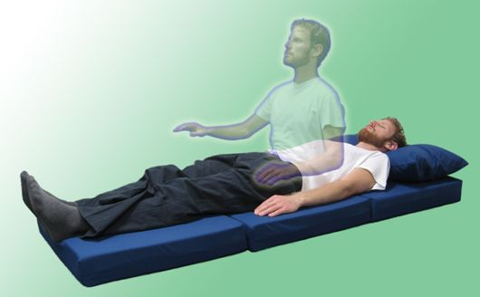 a rendition of a person leaving their body in an out-of-body experience